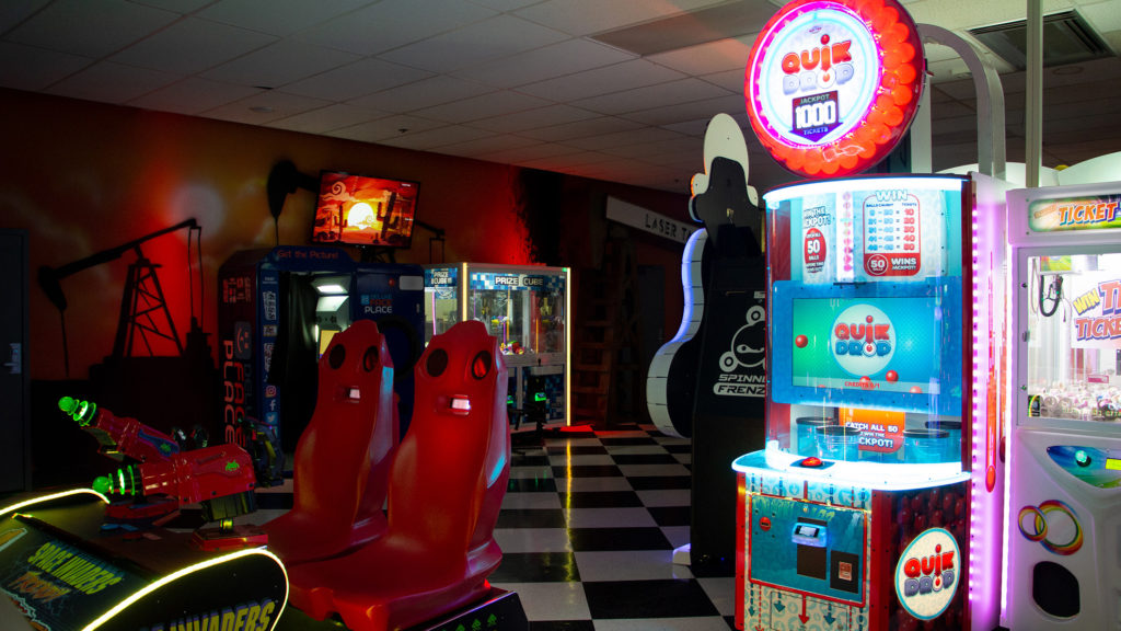 space invader chairs in arcade room